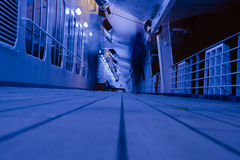 Deck at Night. The decks of a cruise ship are lighted with blue for night travel Royalty Free Stock Image