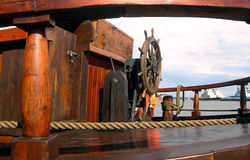 Deck of the old ship. Wooden rudder and deck of the old ship Stock Photo