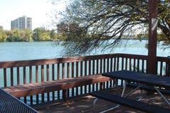 A deck over looking an urban river Stock Photos