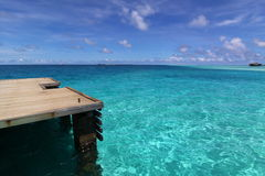 Deck and pier of blue tropical sea, Maldives Stock Images
