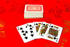 Deck of playing cards. Isolated on red background with gold pattern vector illustration