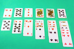 Deck of playing cards. Isolated on green background Stock Images