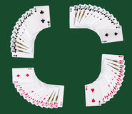Deck of playing cards. Full deck of playing cards on green card table - symmetrical Stock Images