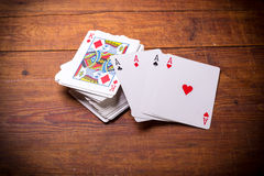 Deck of playing cards with aces. Deck of playing cards with ace cards on top Royalty Free Stock Photo