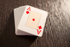 Deck of playing cards showing the ace of diamonds stock images