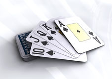 Deck of poker cards revealing royal flush hand. On white table. Poker, black jack, casino cards Stock Photos
