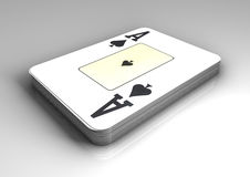 Deck of poker cards with top card as ace of spades on  white table with reflection. Royalty Free Stock Photos