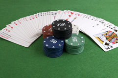 Deck of poker and tokens Royalty Free Stock Photo