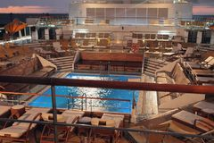Deck with pool on cruise liner at sunset. 22-01-2016 stock image