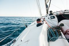 Deck of professional racing yacht leaning in wind royalty free stock photography