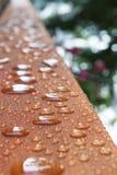 Deck rail after rain Stock Photos