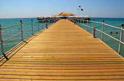 Deck on resort beach (Mediterranean sea, Turkey) stock photography