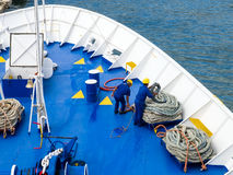 Deck sailors are working with ropes Royalty Free Stock Photo