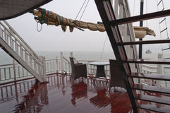 Deck of a ship in the rain. In Halong Bay Royalty Free Stock Images