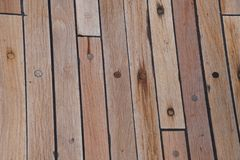 The deck is on the ship. wood texture. surface. brown. Structure. board stock photography