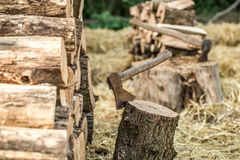 A deck of stacked logs and an axe Stock Photography