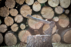 A deck of stacked logs and an axe Royalty Free Stock Photo
