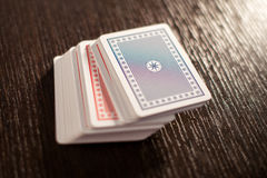 Deck of stacked playing cards on a table Stock Photos