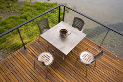 Deck Table Sitting Area Deck over Ocean Waterway Royalty Free Stock Photos