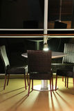 On deck. Table and chairs on deck of cruise ship at night Royalty Free Stock Photo