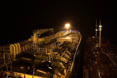 Deck of the tanker at night. Cargo deck of the tanker at night, in the light of lanterns Stock Image