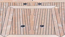 Deck of teak. Yacht deck, made in teak in the Genoa port during the boat show Royalty Free Stock Photo