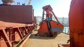 The deck of the vessel on which the ladle of the loading crane l Stock Images