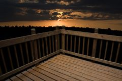 Deck with a View. A deck against a sunset background Royalty Free Stock Photography