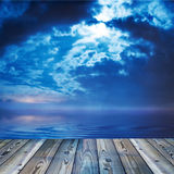 Deck view. Of a ocean or lake during twilight Stock Images