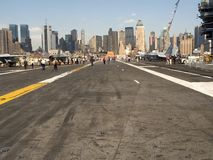 Deck View of NY. This a view of the New York City skyline from the deck of an aircraft carrier royalty free stock photos
