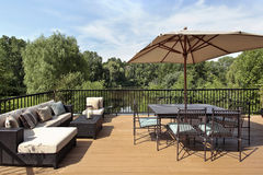 Deck with water view. Deck of luxury home with water view Royalty Free Stock Image