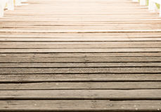 Deck wood walk way. With light over, background, earth tone stock image