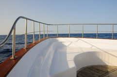 Deck of yacht. Prow of big wooden yacht in the sea Royalty Free Stock Image