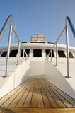 Deck of yacht. Deck of big wooden marine yacht with ladder and deck cabin stock image