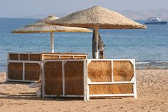 Deckchair on a beach. Empty deckchairs with umbrella on the beach Royalty Free Stock Image