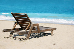 Deckchair on the beach Stock Images