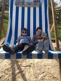 Deckchair. Big chair Little people Stock Images