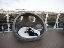 Deckchair in cruise. Wicker lounger on luxury cruise, vacation and relaxation Royalty Free Stock Images