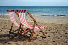 Deckchair. 2 deckchairs on the beach after a refreshing rain Royalty Free Stock Images