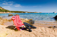 Deckchair with diving mask and flipper, on the beach, sunny day Royalty Free Stock Photos