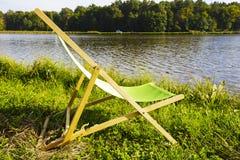 Deckchair en el lago fotos de archivo libres de regalías