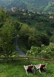 Deckchair and garden in Corsica village. Village in Costa verde mountains Royalty Free Stock Image