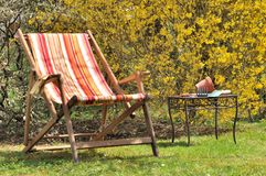 Deckchair in the garden Stock Images