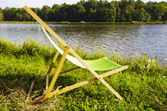 Deckchair at the lake Royalty Free Stock Photos
