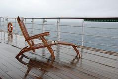 Deckchair lluvioso en Queen Mary 2 Imágenes de archivo libres de regalías