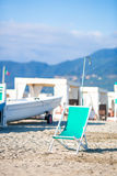 Deckchair mint color on european beach in Italy Stock Photography
