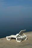 Deckchair no embaçamento da manhã. Foto de Stock Royalty Free