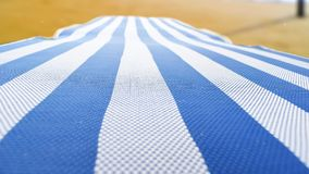 Deckchair på stranden Arkivfoto
