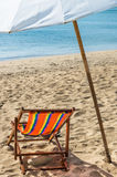 Deckchair and Parasol. On a solitary beach in Ko Lanta, Thailand Stock Photography
