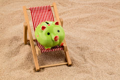 Deckchair with piggy bank Royalty Free Stock Photography